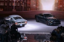 "The new 2019 Mustang BULLITT shares the Ford stage at the North American International Auto Show with the original 1968 Mustang GT driven by legend Steve McQueen during filming on the movie ""Bullitt."""